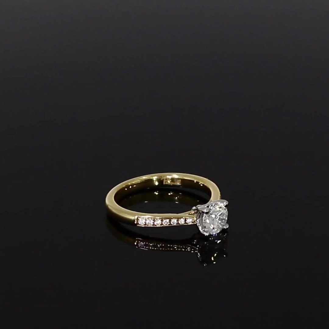 0.73CT Diamond Solitaire Ring<br /> Yellow Gold and Platinum Duchess Setting