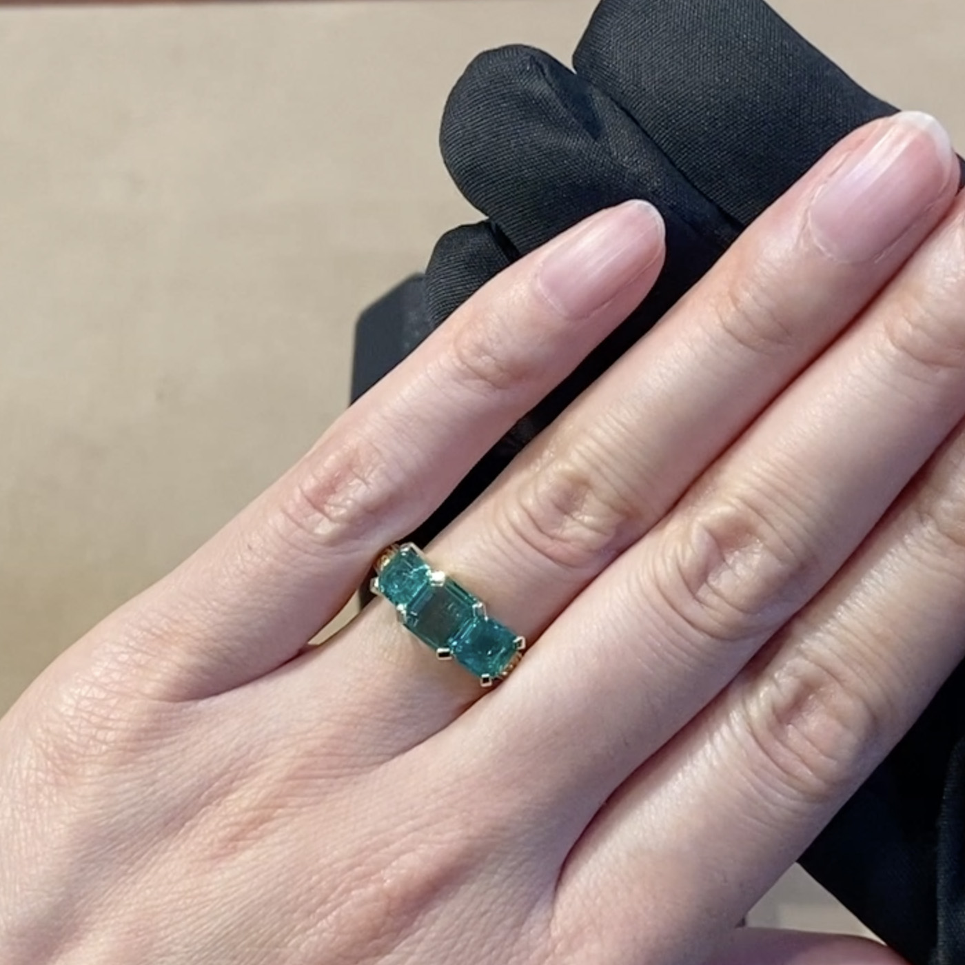 Three Stone Rectangular Cut Emerald Ring 2.03ct <br />  in Yellow Gold, with Carved Leaf Design Shank