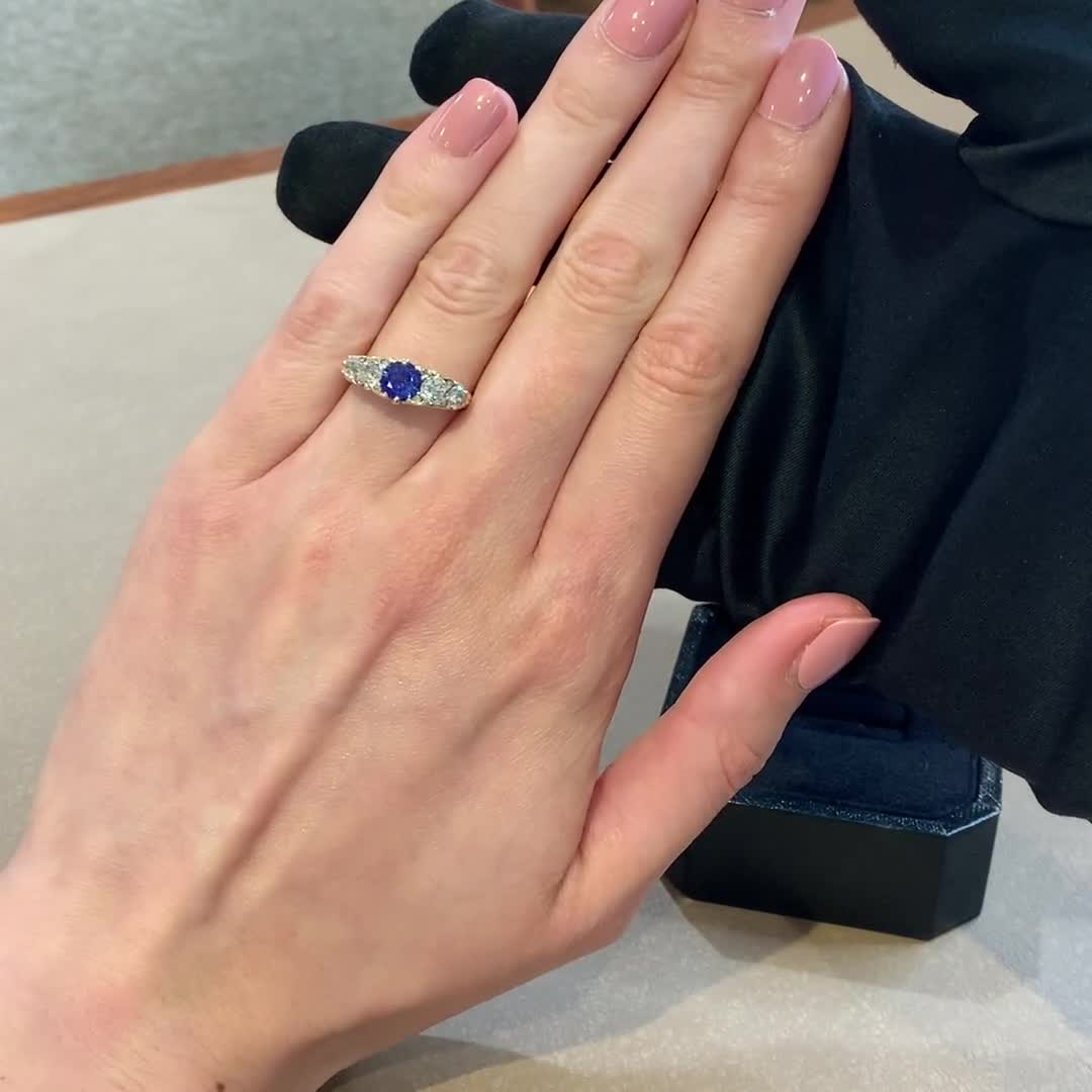 Brilliant Cut Sapphire and Diamond Ring<br /> 0.97CT in 18CT Yellow Gold