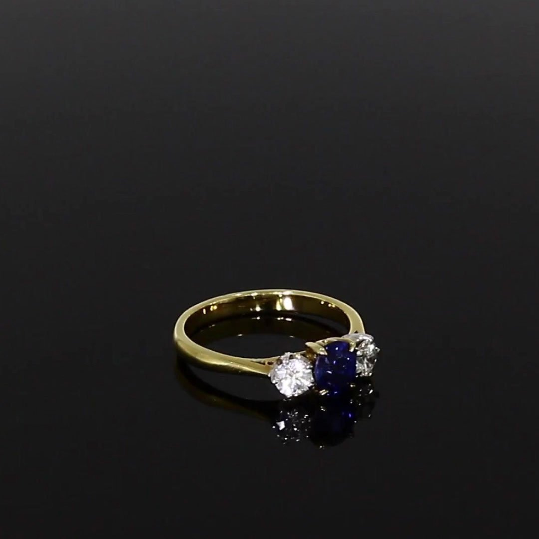 Oval Cut Sapphire and Diamond Ring<br /> 1.33CT in 18CT Yellow Gold