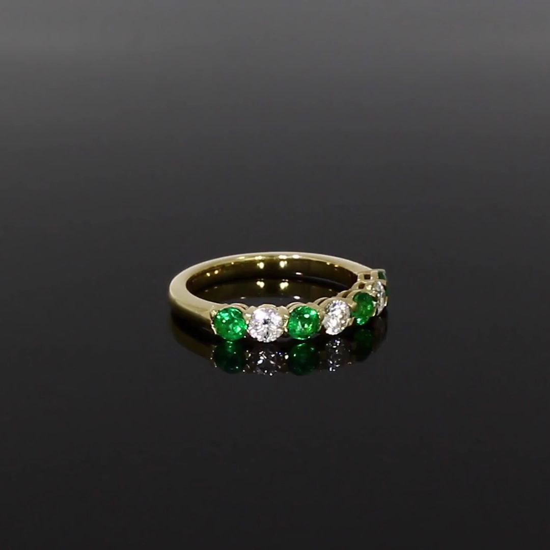 Emerald and Diamond Seven-Stone Ring<br /> 1.03CT in 18CT Yellow Gold