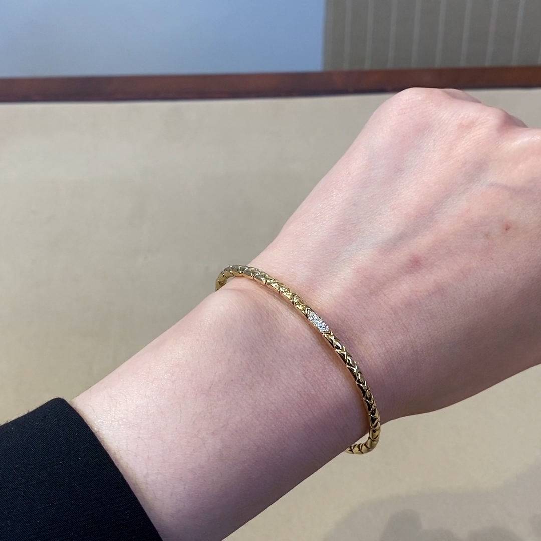 Groove Diamond Textured Bangle<br /> 0.10CT in Yellow Gold